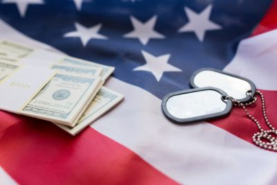american flag, dollar money and military badges